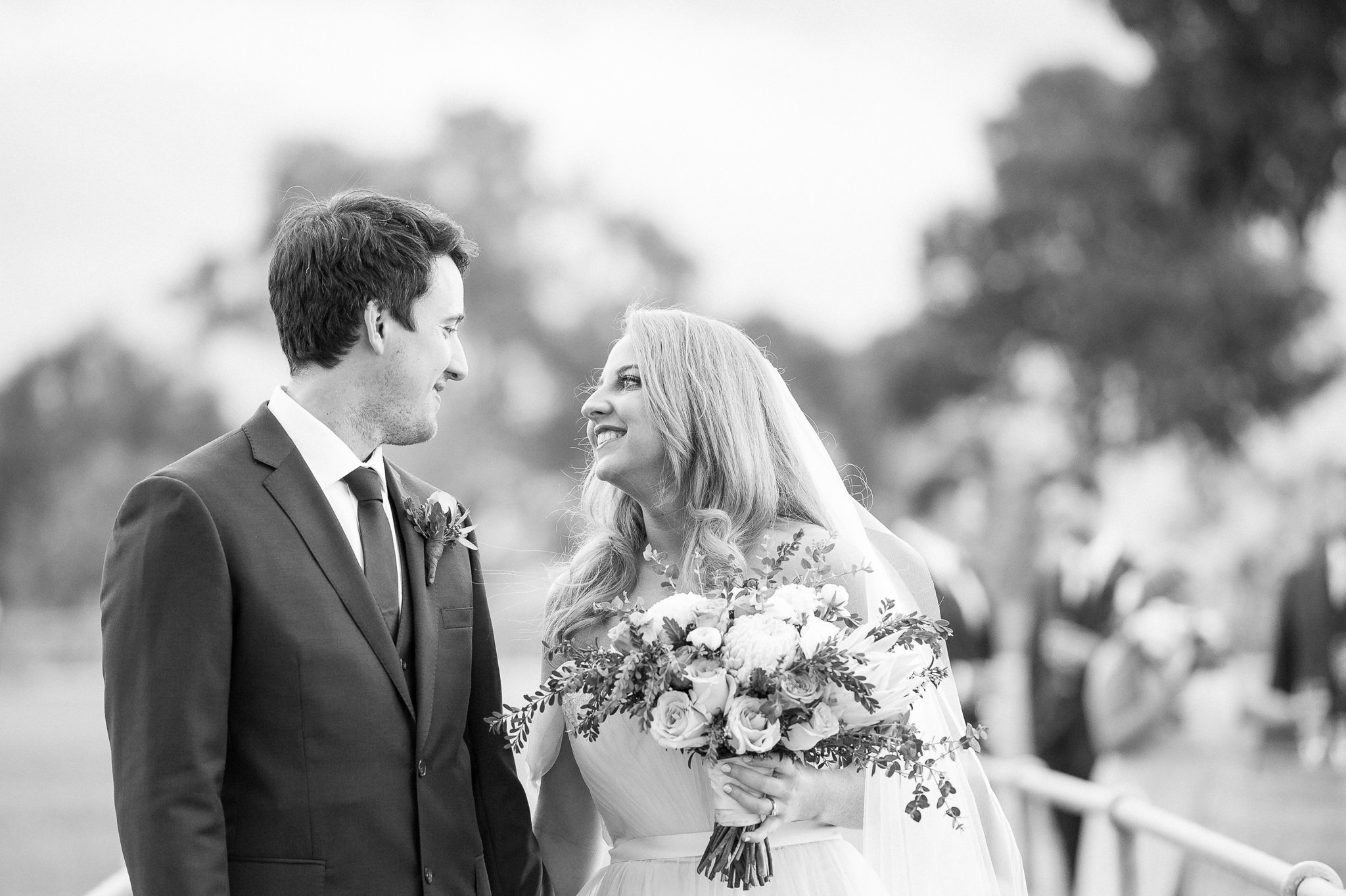 black and white Bride and groom looking at eachother