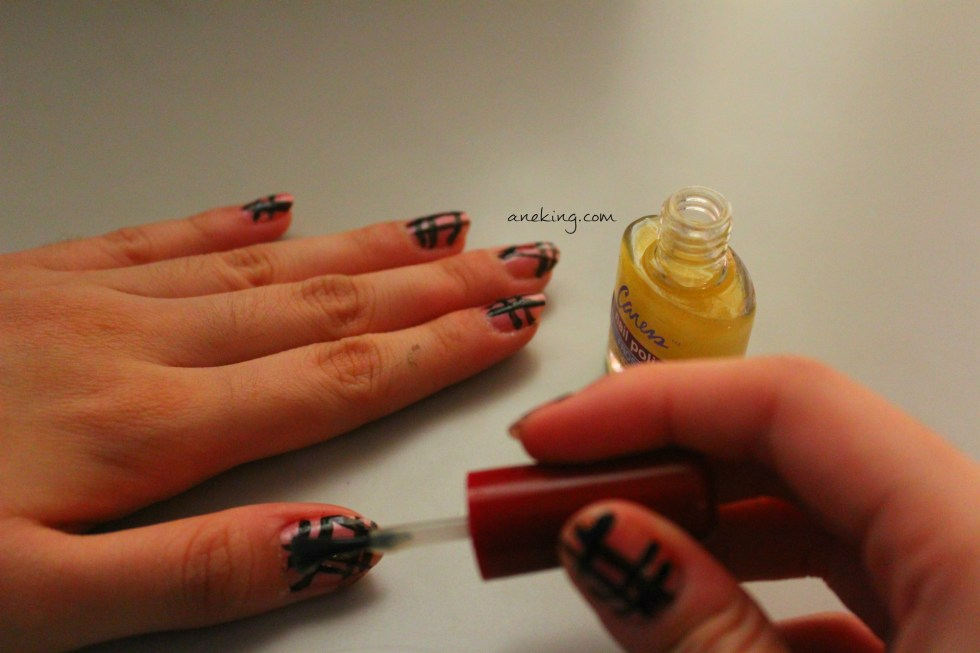 4. End your nail art with top coat.
