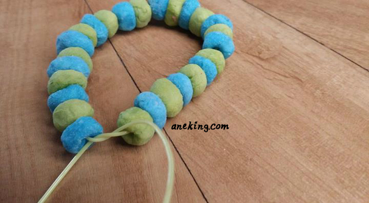 14. Secure its ends with knots if the length of the beaded string perfectly fits your wrists.