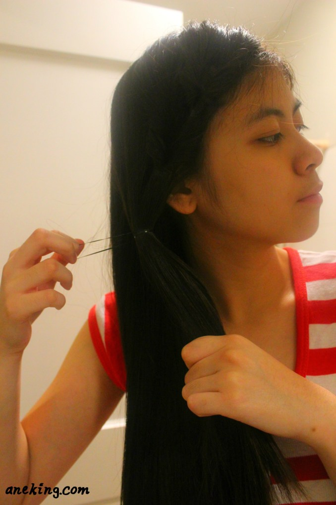 6. Grab a bigger chunk of hair including the second inverse ponytail and tie just beneath it.