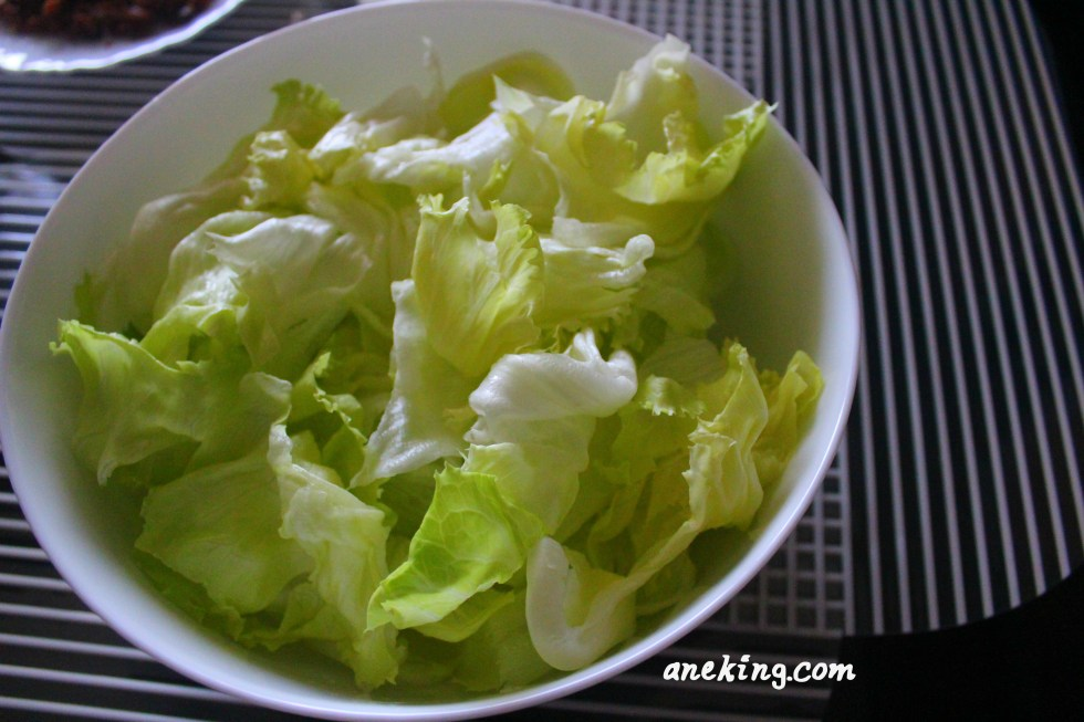 9. Place the lettuce in a bowl.