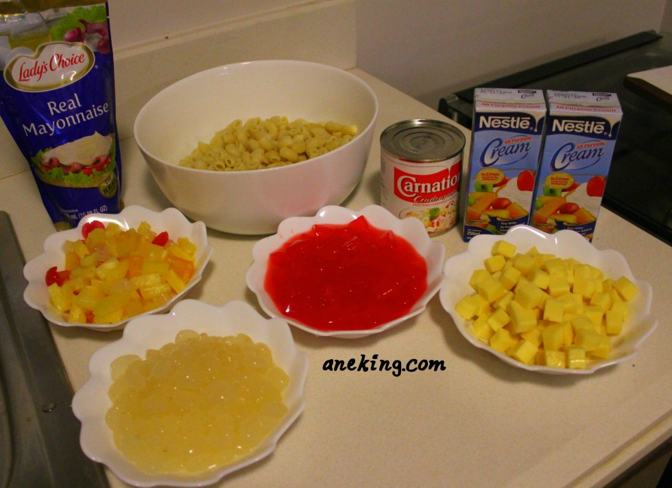 3. It's now the time to prepare the ingredients in one table! This includes the cooked macaroni pasta, condensed milk, all purpose cream, fruit cocktail, cheese, nata de coco, kaong and Lady'