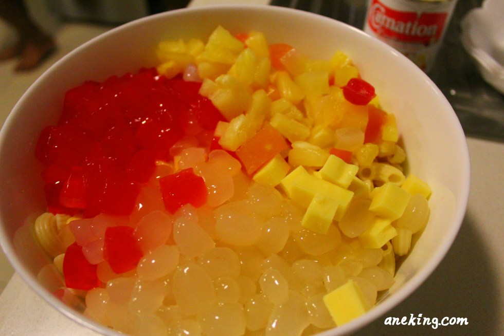 5. Add the fruit cocktail, small-cubed cheese, nata de coco and kaong in the mixture.