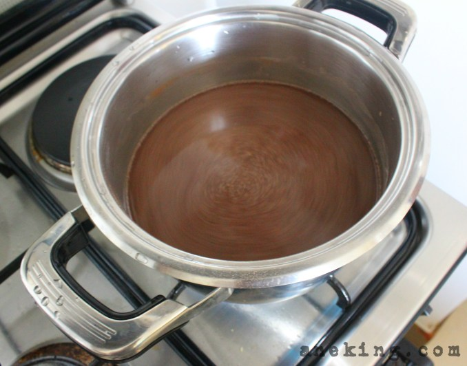 5. While chilling, make the filling by boiling champorado mix, half cup of sugar and water together.