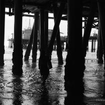 Strolling beneath Santa Monica Pier