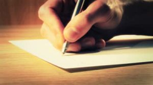 stock-footage-writing-a-letter-close-up