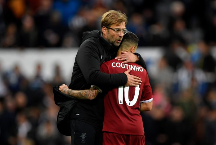 NEWCASTLE UPON TYNE, ENGLAND - OCTOBER 01: Jurgen Klopp, Manager of Liverpool and Philippe Coutinho of Liverpool embrace after the Premier League match between Newcastle United and Liverpool at St. James Park on October 1, 2017 in Newcastle upon Tyne, England.