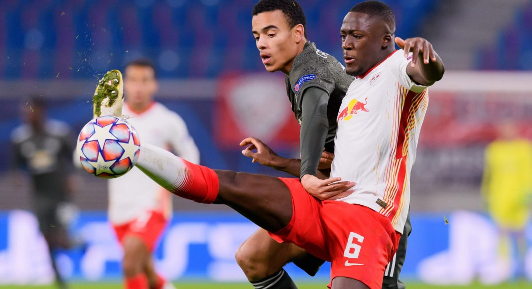 LEIPZIG, GERMANY - DECEMBER 08: (BILD ZEITUNG OUT) Mason Greenwood of Manchester United and Ibrahima Konate of RasenBallsport Leipzig battle for the ball during the UEFA Champions League Group H stage match between RB Leipzig and Manchester United at Red Bull Arena on December 8, 2020 in Leipzig, Germany.