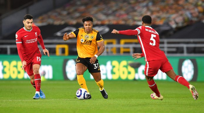 WOLVERHAMPTON, ENGLAND - MARCH 15: Adama Traore of Wolverhampton Wanderers runs with the ball whilst under pressure from Ozan Kabak and Georginio Wijnaldum of Liverpool during the Premier League match between Wolverhampton Wanderers and Liverpool at Molineux on March 15, 2021 in Wolverhampton, England.