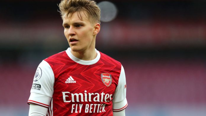 LONDON, ENGLAND - MARCH 14: Martin Odegaard of Arsenal during the Premier League match between Arsenal and Tottenham Hotspur at Emirates Stadium on March 14, 2021 in London, England.