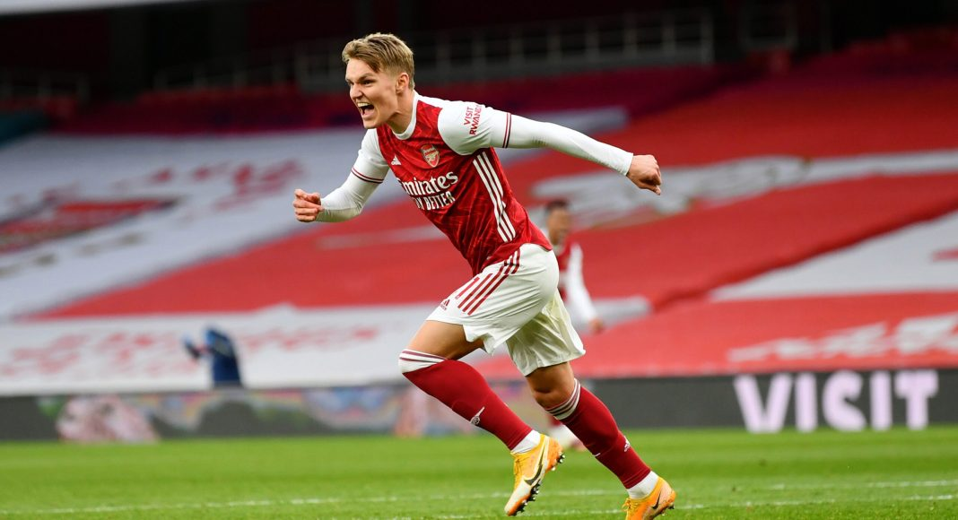 LONDON, ENGLAND - MARCH 14: Martin Odegaard of Arsenal celebrates after scoring their side's first goal during the Premier League match between Arsenal and Tottenham Hotspur at Emirates Stadium on March 14, 2021 in London, England.
