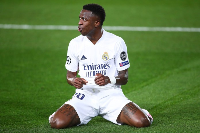MADRID, SPAIN - APRIL 06: Vinicius Junior of Real Madrid celebrates scoring a goal during the UEFA Champions League Quarter Final match between Real Madrid and Liverpool FC at Estadio Alfredo Di Stefano on April 06, 2021 in Madrid, Spain.