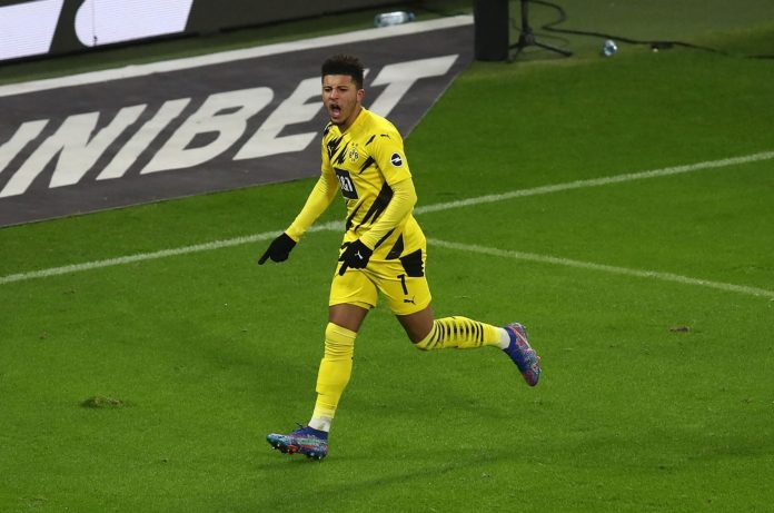 LEIPZIG, GERMANY - JANUARY 09: Jadon Sancho of Borussia Dortmund celebrates after scoring their team's first goal during the Bundesliga match between RB Leipzig and Borussia Dortmund at Red Bull Arena on January 09, 2021 in Leipzig, Germany.