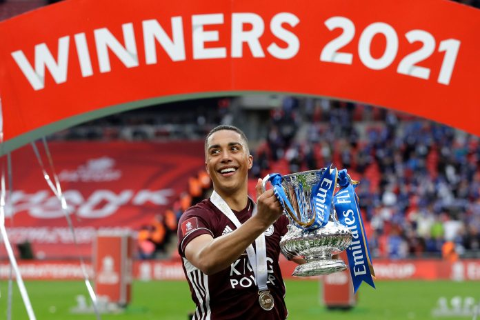 LONDON, ENGLAND - MAY 15: Youri Tielemans of Leicester City celebrates with the Emirates FA Cup trophy following The Emirates FA Cup Final match between Chelsea and Leicester City at Wembley Stadium on May 15, 2021 in London, England.