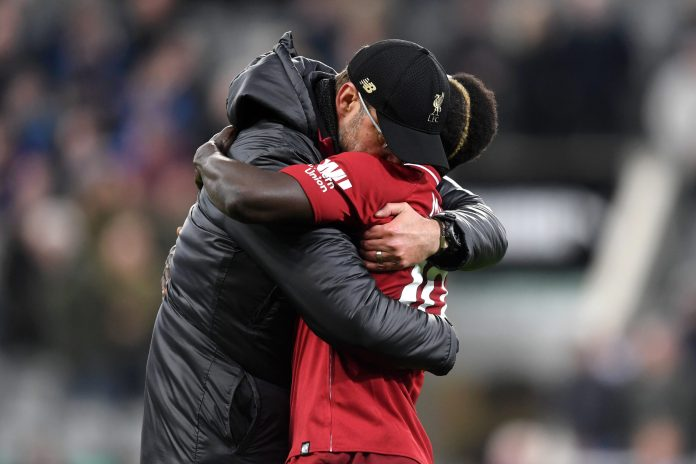 NEWCASTLE UPON TYNE, ENGLAND - MAY 04: Jurgen Klopp, Manager of Liverpool embraces Sadio Mane of Liverpool after the Premier League match between Newcastle United and Liverpool FC at St. James Park on May 04, 2019 in Newcastle upon Tyne, United Kingdom.