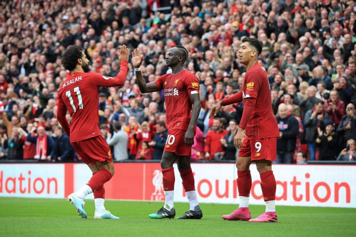 LIVERPOOL, ENGLAND - OCTOBER 05: Sadio Mane of Liverpool (C) celebrates with teammates Mohamed Salah of Liverpool (L) and Roberto Firmino of Liverpool (R) after scoring their 1st goal during the Premier League match between Liverpool FC and Leicester City at Anfield on October 5, 2019 in Liverpool, United Kingdom.
