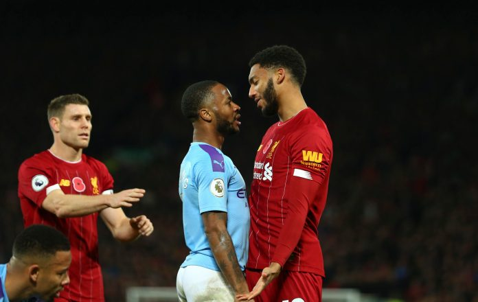 LIVERPOOL, ENGLAND - NOVEMBER 10: Raheem Sterling of Manchester City and Joe Gomez of Liverpool during the Premier League match between Liverpool FC and Manchester City at Anfield on November 10, 2019 in Liverpool, United Kingdom.