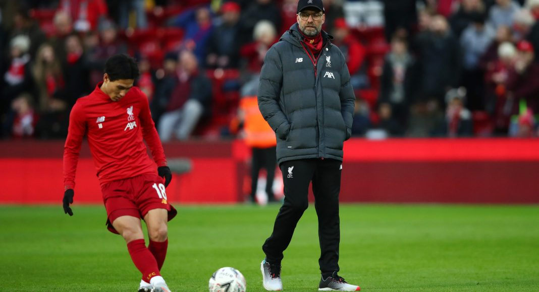 LIVERPOOL, ENGLAND - JANUARY 05: Jurgen Klopp, Manager of Liverpool watches as Takumi Minamino of Liverpool warms up prior to the FA Cup Third Round match between Liverpool and Everton at Anfield on January 05, 2020 in Liverpool, England.