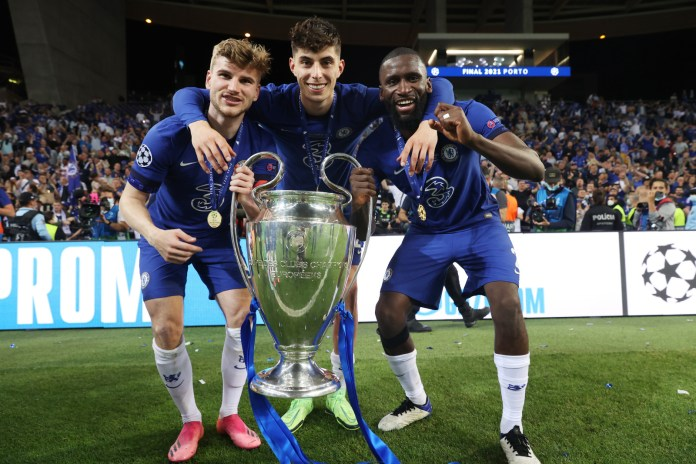Timo Werner (L), Kai Havertz (C) and Antonio Ruediger (R) of Chelsea celebrate with the trophy at the end of the UEFA Champions League final match against Manchester City at Dragao Stadium on May 29, 2021 in Porto, Portugal. Chelsea won the 2021 Champions League title after beating Manchester City 1-0 in the final on Saturday.