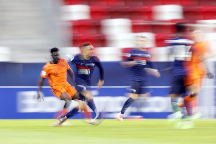 BUDAPEST - (lr) Azor Matusiwa of Holland, Maxence Caqueret of France during the UEFA EURO U21 quarter-final match between the Netherlands U21 and France U21 at the Bozsik Arena on May 31, 2021 in Budapest, Hungary. ANP ROBIN VAN LONKHUIJSEN (Photo by ANP Sport via Getty Images)