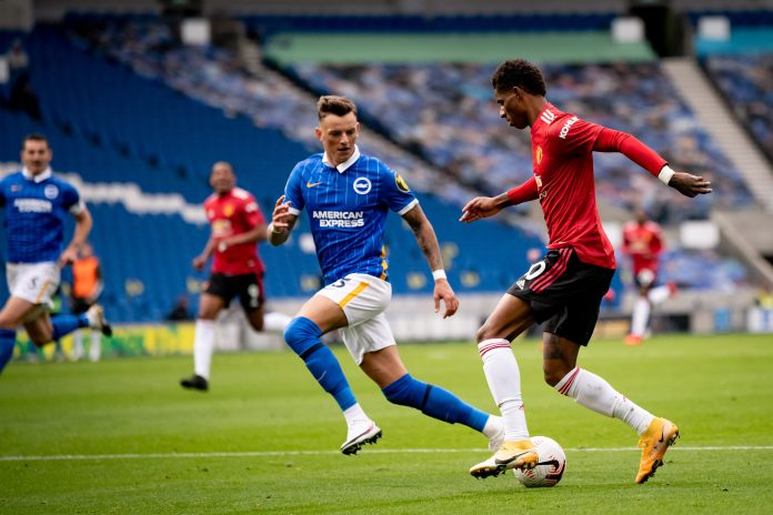 BRIGHTON, ENGLAND - SEPTEMBER 26: Marcus Rashford of Manchester United in action with Ben White of Brighton and Hove Albion during the Premier League match between Brighton & Hove Albion and Manchester United at American Express Community Stadium on September 26, 2020 in Brighton, England.