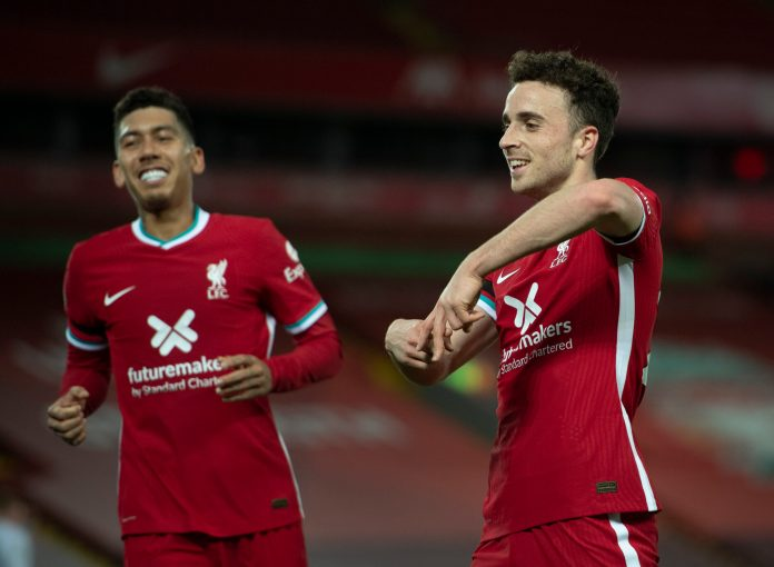 LIVERPOOL, ENGLAND - NOVEMBER 22: Diogo Jota of Liverpool celebrates scoring with team mate Roberto Firmino during the Premier League match between Liverpool and Leicester City at Anfield on November 22, 2020 in Liverpool, United Kingdom.