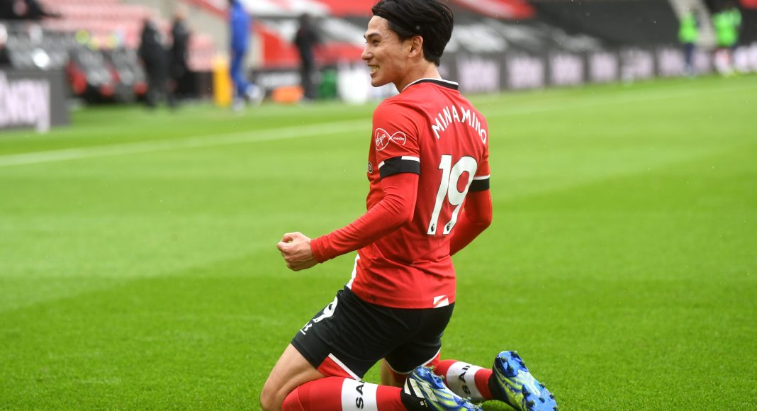 SOUTHAMPTON, ENGLAND - FEBRUARY 20: Takumi Minamino of Southampton celebrates after scoring his team's first goal during the Premier League match between Southampton and Chelsea at St Mary's Stadium on February 20, 2021 in Southampton, England.