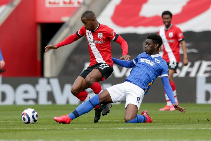 SOUTHAMPTON, ENGLAND - MARCH 14: Ibrahima Diallo of Southampton and Yves Bissouma of Brighton & Hove Albion during the Premier League match between Southampton and Brighton & Hove Albion at St Mary's Stadium on March 14, 2021 in Southampton, England.