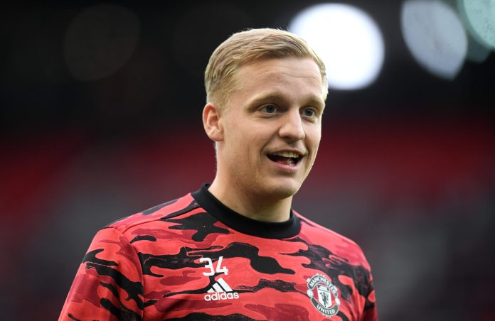MANCHESTER, ENGLAND - MAY 13: Donny van de Beek of Manchester United reacts as he warms up prior to the Premier League match between Manchester United and Liverpool at Old Trafford on May 13, 2021 in Manchester, England.