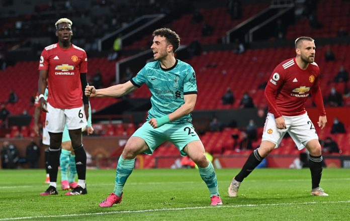 MANCHESTER, ENGLAND - MAY 13: Diogo Jota of Liverpool celebrates after scoring their side's first goal during the Premier League match between Manchester United and Liverpool at Old Trafford on May 13, 2021 in Manchester, England