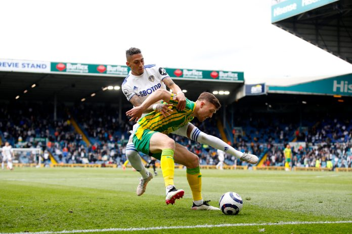 LEEDS, ENGLAND - MAY 23: Raphinha of Leeds United challenges Dara O'Shea of West Bromwich Albion during the Premier League match between Leeds United and West Bromwich Albion at Elland Road on May 23, 2021 in Leeds, England.