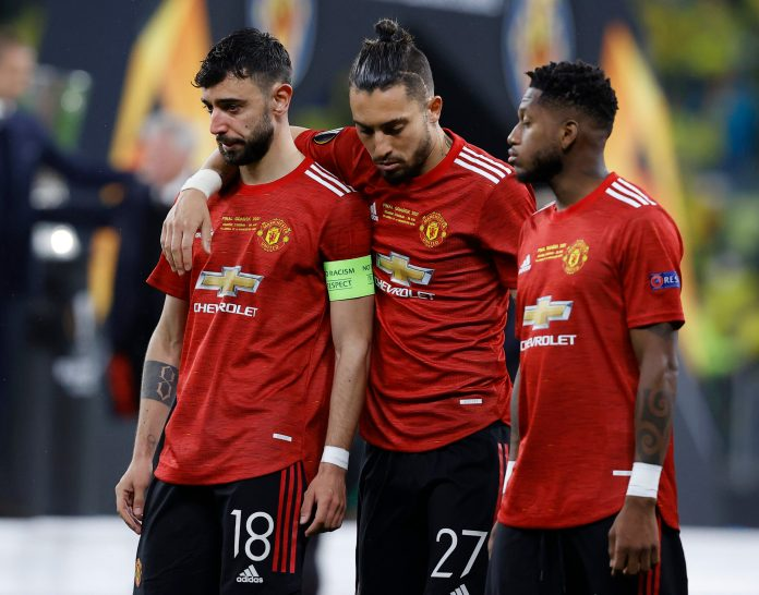 GDANSK, POLAND - MAY 26: (L-R) Bruno Fernandes, Alex Telles and Fred of Manchester United look dejected following the UEFA Europa League Final between Villarreal CF and Manchester United at Gdansk Arena on May 26, 2021 in Gdansk, Poland.