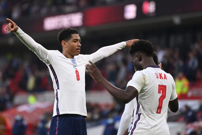 MIDDLESBROUGH, ENGLAND - JUNE 02: Jude Bellingham of England celebrates his side's first goal scored by team mate Bukayo Saka during the international friendly match between England and Austria at Riverside Stadium on June 02, 2021 in Middlesbrough, England.
