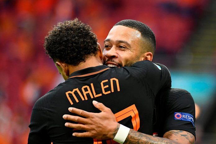 AMSTERDAM, NETHERLANDS - JUNE 21: Memphis Depay of Netherlands celebrates with teammate Donyell Malen after scoring their side's first goal during the UEFA Euro 2020 Championship Group C match between North Macedonia and The Netherlands at Johan Cruijff Arena on June 21, 2021 in Amsterdam, Netherlands.