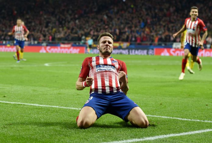 MADRID, SPAIN - NOVEMBER 06: Saul Niguez of Atletico Madrid celebrates after scoring his team's first goal during the Group A match of the UEFA Champions League between Club Atletico de Madrid and Borussia Dortmund at Estadio Wanda Metropolitano on November 6, 2018 in Madrid, Spain. (Photo by Denis Doyle/Getty Images)