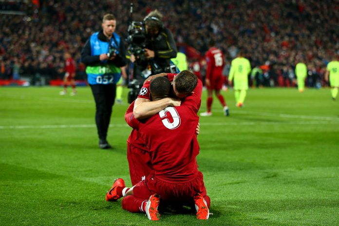 LIVERPOOL, ENGLAND - MAY 07: James Milner of Liverpool and Georginio Wijnaldum of Liverpool celebrates at full time during the UEFA Champions League Semi Final second leg match between Liverpool and Barcelona at Anfield on May 7, 2019 in Liverpool, England.