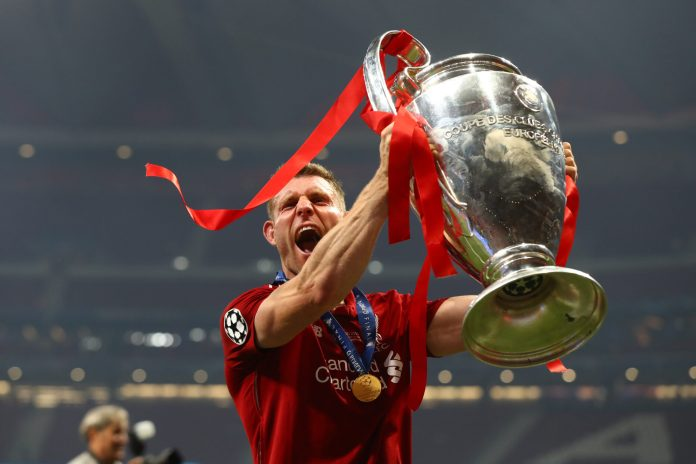 MADRID, SPAIN - JUNE 01: James Milner of Liverpool celebrates with the Champions League Trophy after winning the UEFA Champions League Final between Tottenham Hotspur and Liverpool at Estadio Wanda Metropolitano on June 01, 2019 in Madrid, Spain.