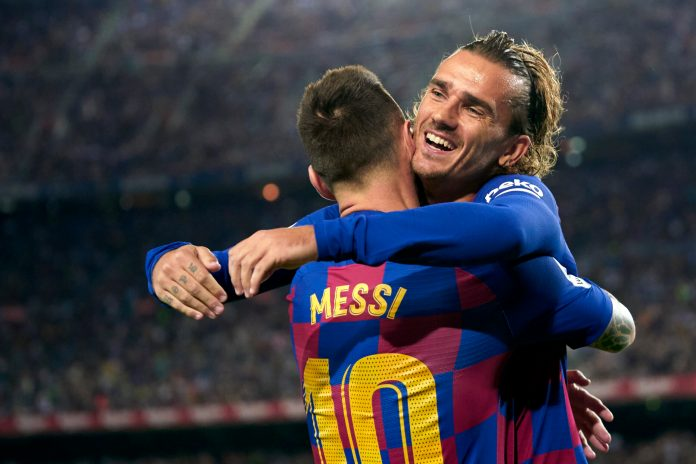 BARCELONA, SPAIN - SEPTEMBER 24: Antoine Griezmann and Lionel Messi of FC Barcelona celebrating their team's first goal during the Liga match between FC Barcelona and Villarreal CF at Camp Nou on September 24, 2019 in Barcelona, Spain.