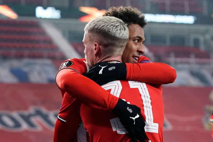 EINDHOVEN, NETHERLANDS - DECEMBER 10: Donyell Malen of PSV Celebrate his goal, Philipp Max of PSV during the UEFA Europa League match between PSV v Omonia at the Philips Stadium on December 10, 2020 in Eindhoven Netherlands (Photo by Photo Prestige/Soccrates/Getty Images)
