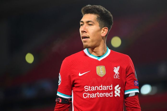 LIVERPOOL, ENGLAND - DECEMBER 01: Roberto Firmino of Liverpool looks on during the UEFA Champions League Group D stage match between Liverpool FC and Ajax Amsterdam at Anfield on December 01, 2020 in Liverpool, England. Sporting stadiums around the UK remain under strict restrictions due to the Coronavirus Pandemic as Government social distancing laws prohibit fans inside venues resulting in games being played behind closed doors. (Photo by Michael Regan/Getty Images)