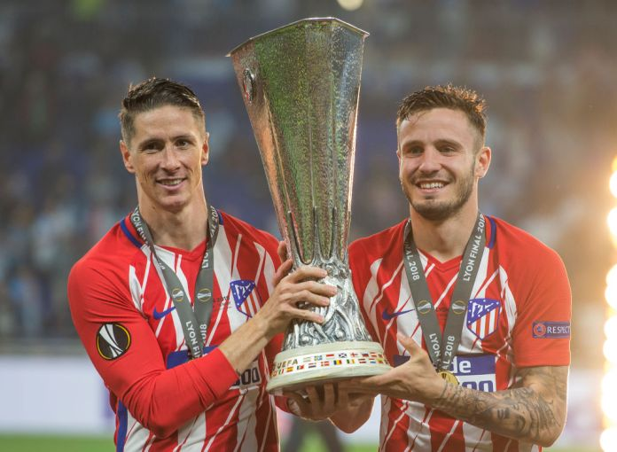LYON, FRANCE - MAY 16: Fernando Torres and Saúl Ñíguez pose with trophy after Atletico Madrid win the UEFA Europa League Final between Olympique de Marseille and Club Atletico de Madrid at Stade de Lyon on May 16, 2018 in Lyon, France. (Photo by Visionhaus/Corbis via Getty Images)