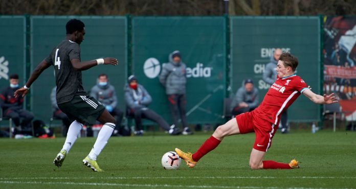 KIRKBY, ENGLAND - MARCH 06: (THE SUN OUT, THE SUN ON SUNDAY OUT) Ethan Ennis of Liverpool and Bjorn Hardley of Manchester United in action during the U18 Premier League game between Liverpool and Manchester United at AXA Training Centre on March 6, 2021 in Kirkby, England. (Photo by Nick Taylor/Liverpool FC/Liverpool FC via Getty Images)