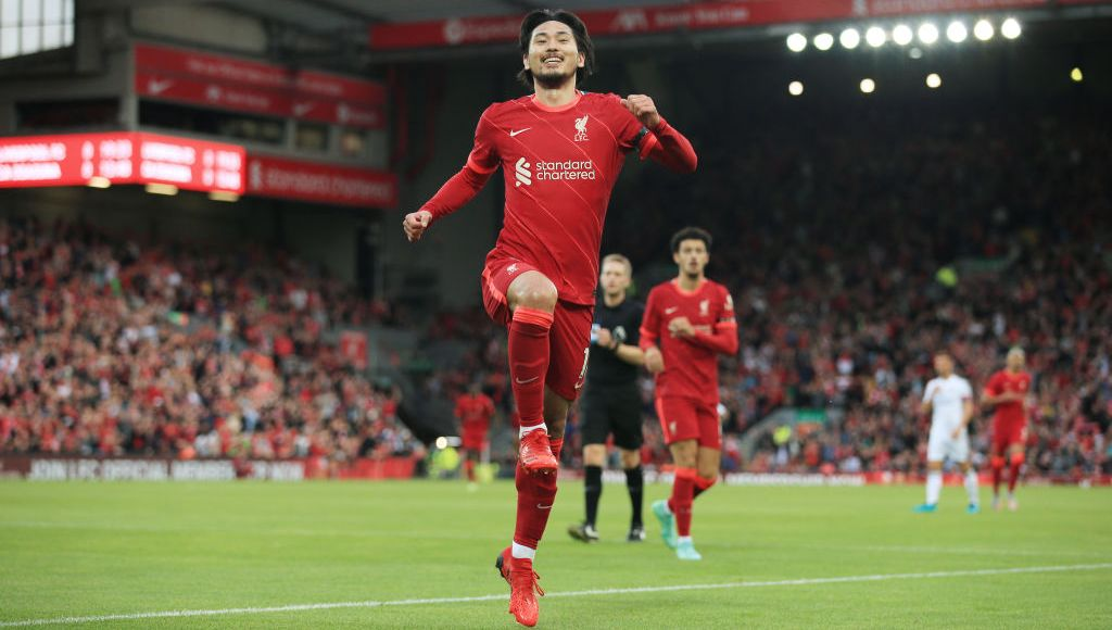 LIVERPOOL, ENGLAND - AUGUST 09: Takumi Minamino of Liverpool celebrates after scoring their 1st goal during the pre-season friendly match between Liverpool and Osasuna at Anfield on August 9, 2021 in Liverpool, England. (Photo by Simon Stacpoole/Offside/Offside via Getty Images)