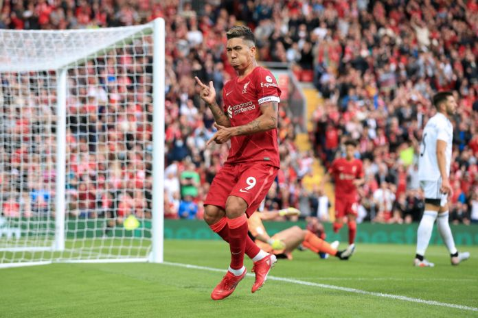LIVERPOOL, ENGLAND - AUGUST 09: Roberto Firmino of Liverpool celebrates after scoring their 2nd goal during the pre-season friendly match between Liverpool and Osasuna at Anfield on August 9, 2021 in Liverpool, England. (Photo by Simon Stacpoole/Offside/Offside via Getty Images)