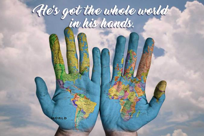 He's Got the Whole World. Hands painted with the globe on a field of clouds