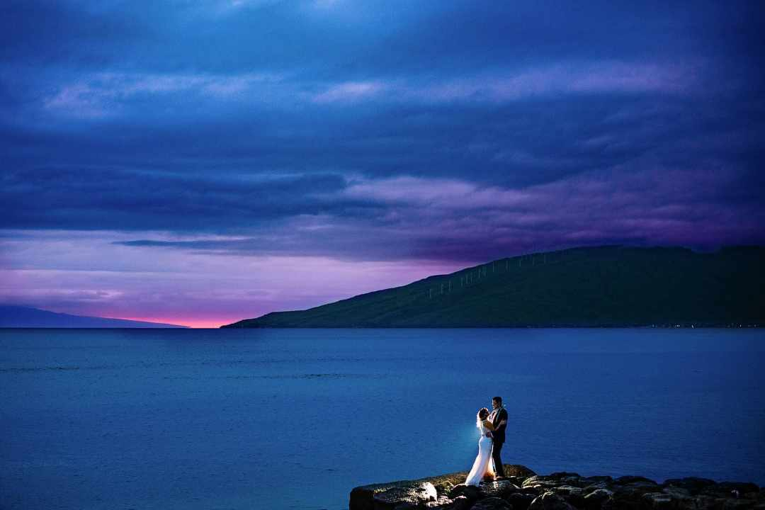 bride and groom backlit with sunset