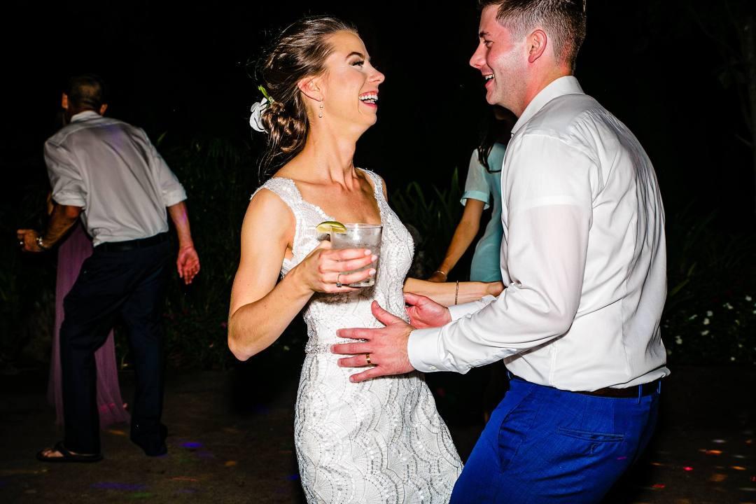 bride and groom dancing at reception at olowalu plantation house