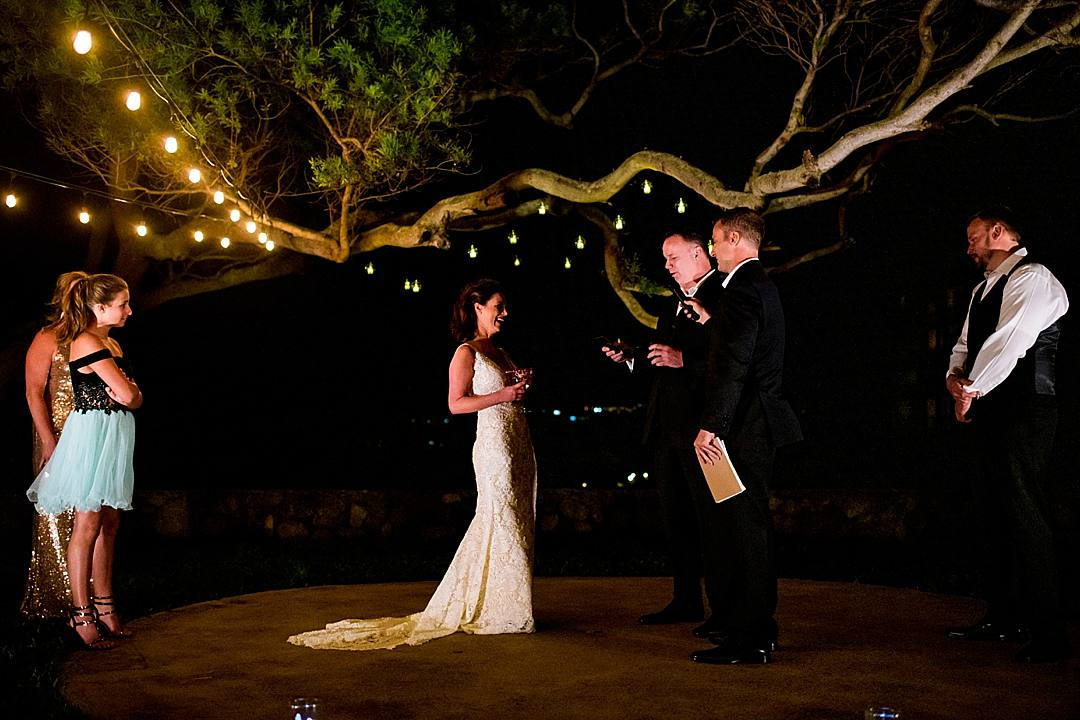bride and groom exchanging vows at candlelit ceremony