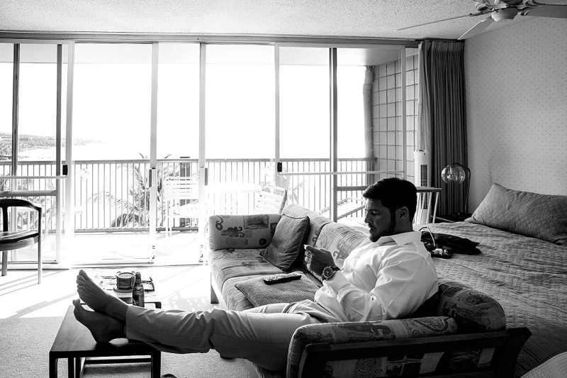 groom relaxing before wedding