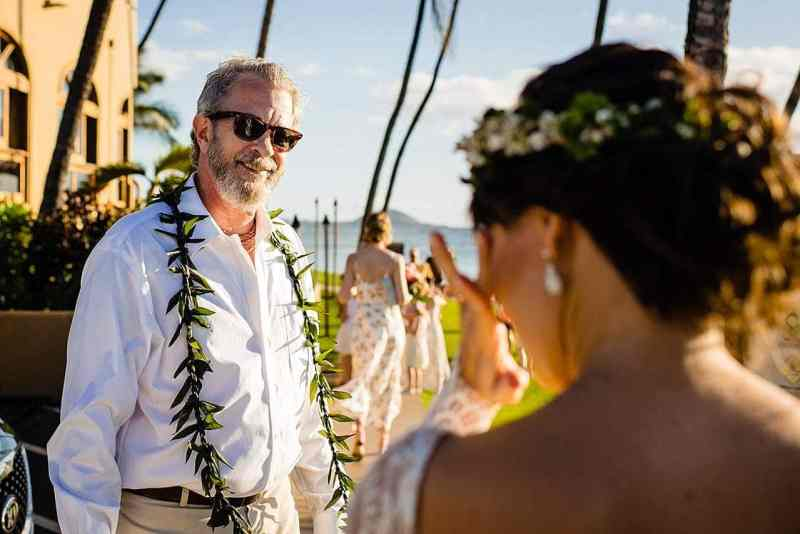dad looking at daughter before ceremony at five palms maui